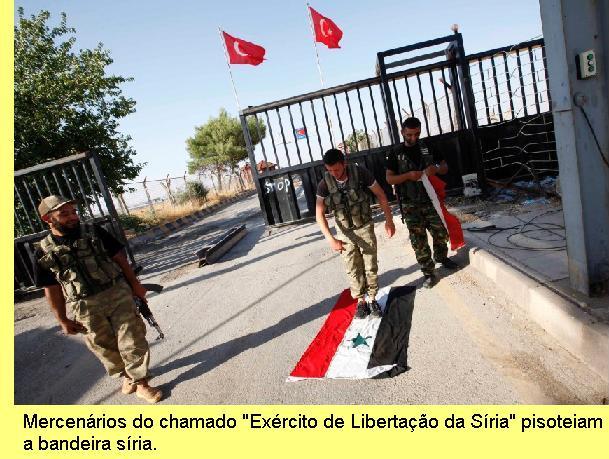 Mercenários pisoteiam a bandeira síria.