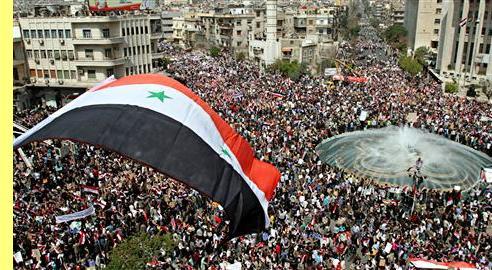 Manifestão de apoio ao governo em Damasco.